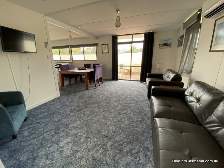 Big4 Strahan Holiday Retreat 4 bedroom cottage living and dining area